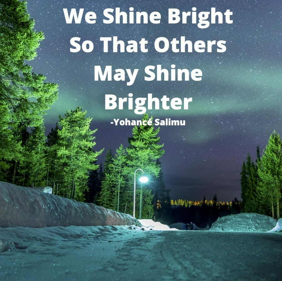positive quote about shining bright for others with beautiful natural aurora borealis night sky in winter night.